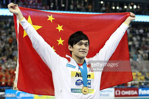 Yang Sun of China celebrates winning the gold medal in a new world record in the Men's 1500m Freestyle Final during Day Sixteen of the 14th FINA...