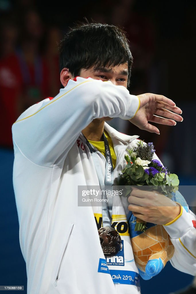 Yang Sun of China cries as he celebrates on the podium after winning the Swimming Men's 800m Freestyle Final on day twelve of the 15th FINA World Championships at Palau Sant Jordi on July 31, 2013 in Barcelona, Spain.