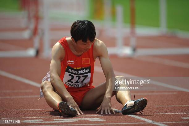 Yang Wang of China shows his dejection just before the finish line after he falls at the final hurdle and fails to finish in the Boys 110m Hurdles...
