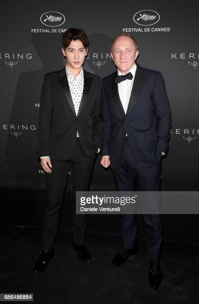Yang Yang and FrancoisHenri Pinault attend the Women in Motion Awards Dinner at the 70th Cannes Film Festival at Place de la Castre on May 21 2017 in...