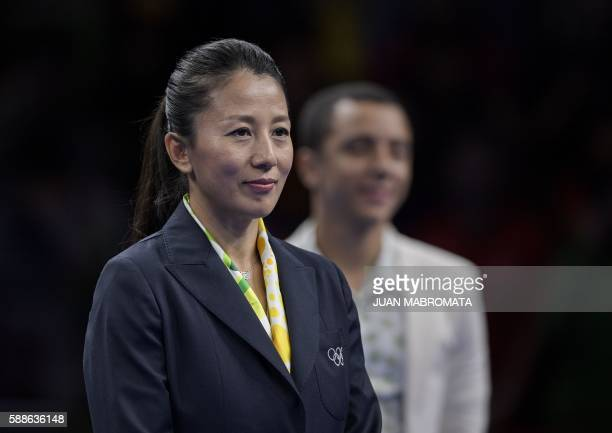 Yang Yang former Chinese short track speed skater and current member of the International Olympic Committee attends the medal ceremony for the men's...