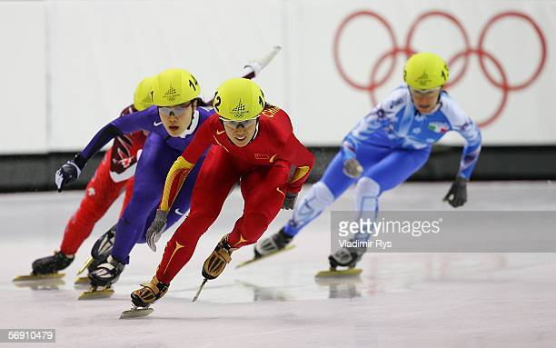 Yang Yang of China leads EunKyung Choi of Korea during the women's 3000m final speed skating during Day 12 of the Turin 2006 Winter Olympic Games on...