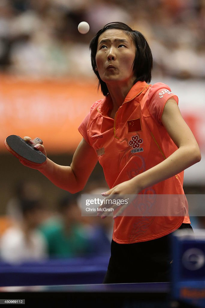 Yang Yanmei of China serves against He Zhuojia of China during their Women's Singles match on day two of 2014 ITTF World Tour Japan Open at Yokohama Cultural Gymnasium on June 21, 2014 in Yokohama, Japan.
