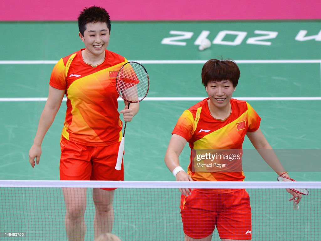 Yang Yu (L) and Xiaoli Wang (R) of China celebrate winning against Valeria Sorokina and Nina Vislova of Russia in Women's Doubles Badminton on Day 2 of the London 2012 Olympic Games at Wembley Arena on July 29, 2012 in London, England.