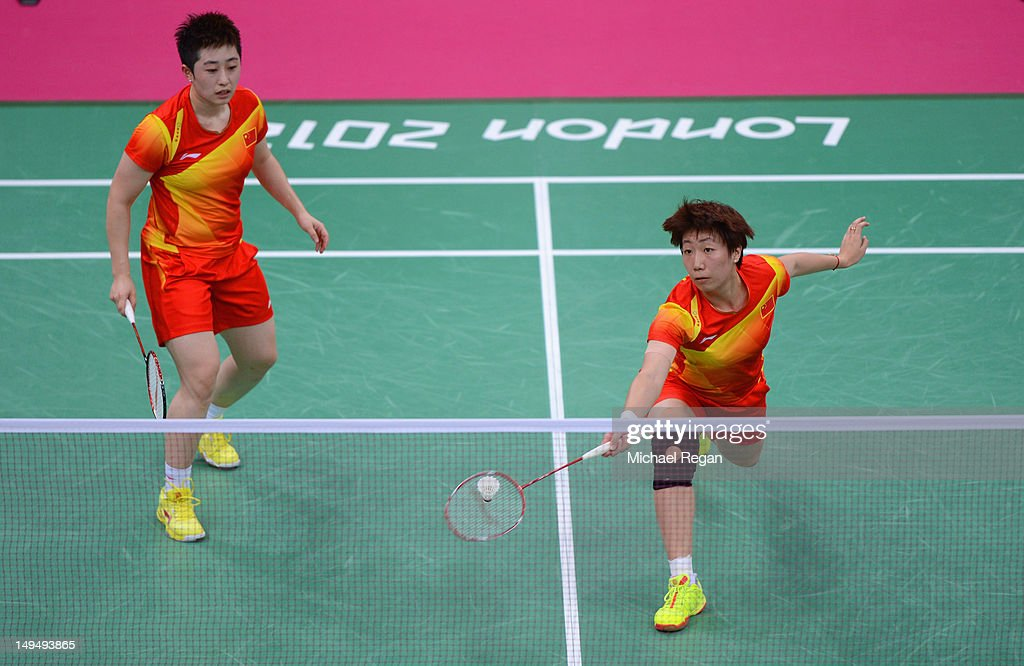 Yang Yu (L) and Xiaoli Wang (R) of China return against Valeria Sorokina and Nina Vislova of Russia in Women's Doubles Badminton on Day 2 of the London 2012 Olympic Games at Wembley Arena on July 29, 2012 in London, England.