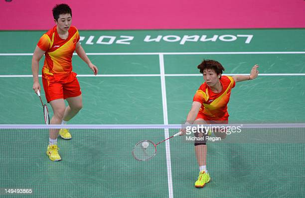 Yang Yu and Xiaoli Wang of China return against Valeria Sorokina and Nina Vislova of Russia in Women's Doubles Badminton on Day 2 of the London 2012...