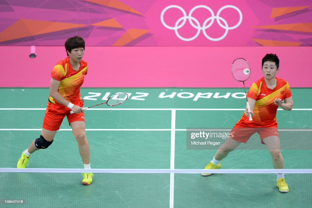 Yang Yu (R) and Xiaoli Wang (L) of China returns a shot against Michele Li and Alex Bruce of Canada during their Women's Doubles Badminton on Day 1 of the London 2012 Olympic Games at Wembley Arena on July 28, 2012 in London, England.