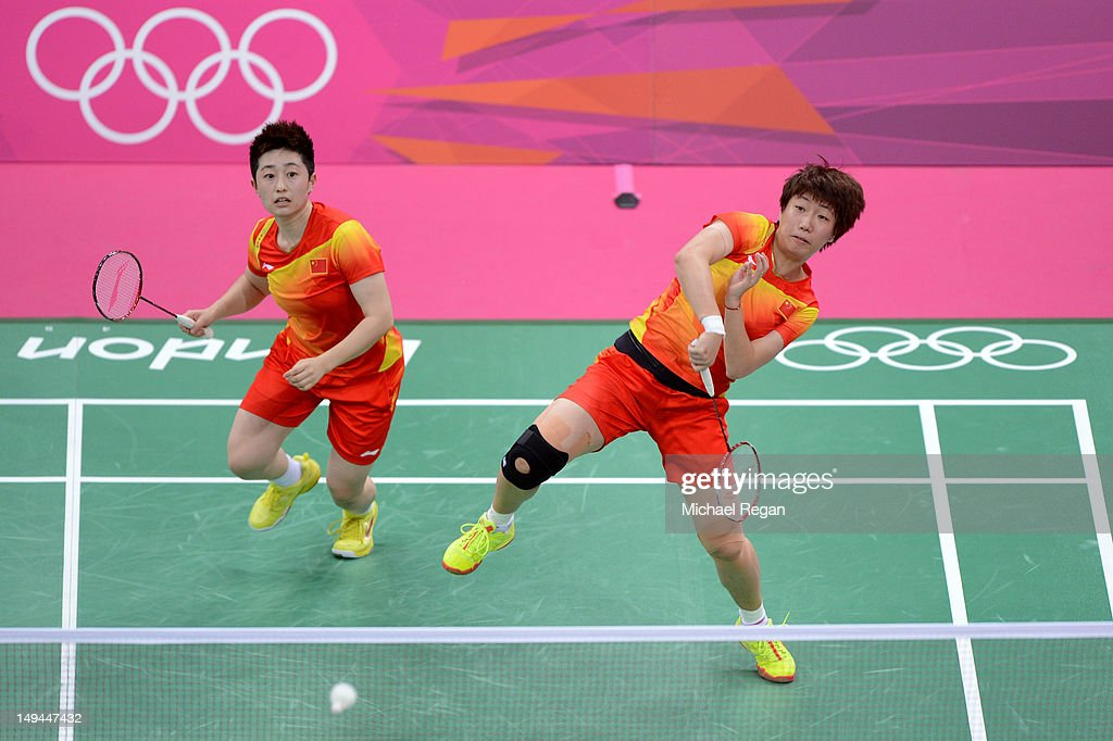 Yang Yu (L) and Xiaoli Wang (R) of China returns a shot against Michele Li and Alex Bruce of Canada during their Women's Doubles Badminton on Day 1 of the London 2012 Olympic Games at Wembley Arena on July 28, 2012 in London, England.