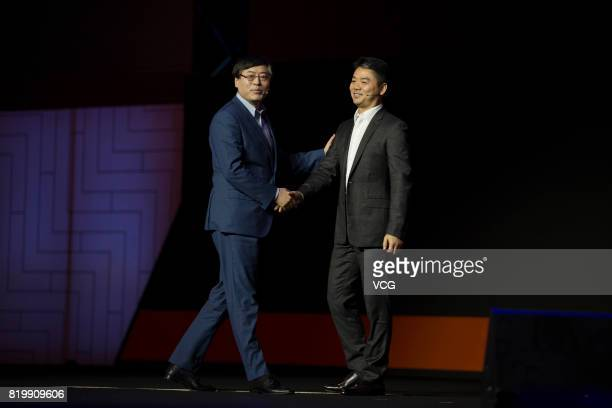 Yang Yuanqing chairman and CEO of Lenovo Group shakes hands with Liu Qiangdong chairman and CEO of JDcom during Lenovo Tech World 2017 at Shanghai...