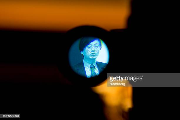 Yang Yuanqing chairman and chief executive officer of Lenovo Group Ltd is seen on a camera viewfinder speaking during a news conference in Hong Kong...