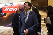 Yang Yuanqing chairman and chief executive officer of Lenovo Group Ltd center arrives at a news conference in Hong Kong China on Thursday May 26 2016...