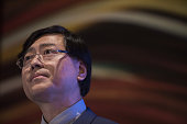 Yang Yuanqing chairman and chief executive officer of Lenovo Group Ltd pauses as he speaks during a news conference in Hong Kong China on Thursday...