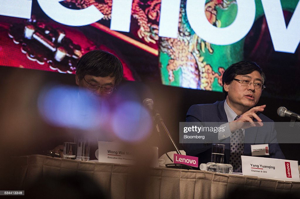 Yang Yuanqing chairman and chief executive officer of Lenovo Group Ltd right speaks during a news conference in Hong Kong China on Thursday May 26...