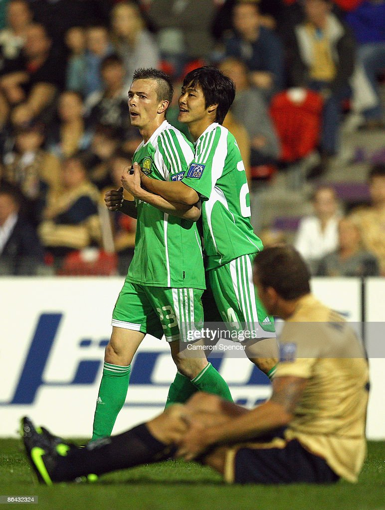 Yang Yun of Guoan congratulates team mate Ryan Griffiths after scoring a goal during the AFC Champions League Group match between the Newcastle Jets...