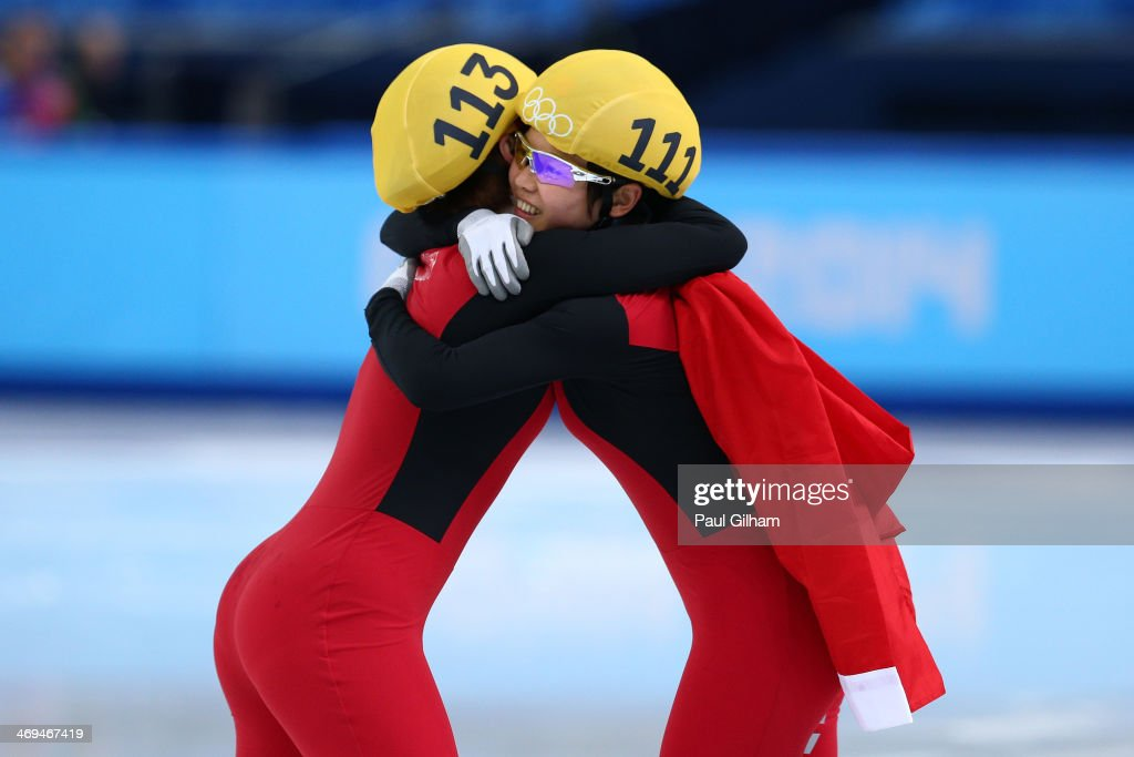Yang Zhou (L) of China is congratulated by Jianrou Li of China after winning the gold medal during the Ladies' 1500 m Final Short Track Speed Skating on day 8 of the Sochi 2014 Winter Olympics at the Iceberg Skating Palace on February 15, 2014 in Sochi, Russia.