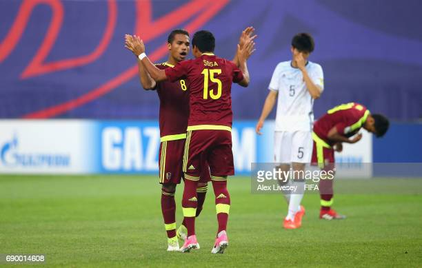 Yangel Herrera of Venezuela celebrates with Samuel Sosa after victory over Japan on the final whistle during the FIFA U20 World Cup Korea Republic...