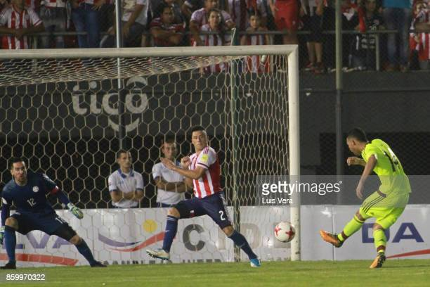 Yangel Herrera of Venezuela kicks the ball to score the first goal of his team during a match between Paraguay and Venezuela as part of FIFA 2018...
