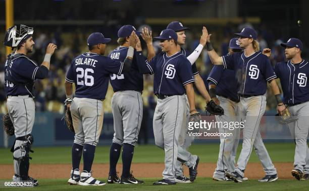 Yangervis Solarte and Hunter Renfroe of the San Diego Padres celebrate with a highfive after their MLB game against the Los Angeles Dodgers at Dodger...