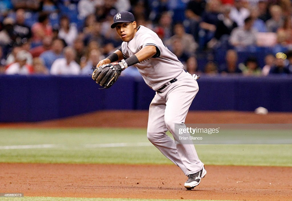Yangervis Solarte #26 of the New York Yankees makes the throw to first to get the out on Yunel Escobar of the Tampa Bay Rays off his grounder to third to end the top of the second inning of a game against the New York Yankees on April 19, 2014 at Tropicana Field in St. Petersburg, Florida.