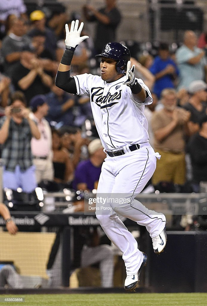 Yangervis Solarte #27 of the San Diego Padres celebrates after hitting a two run home run during the seventh inning of a baseball game against the Colorado Rockies at Petco Park August, 11, 2014 in San Diego, California.