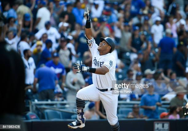 Yangervis Solarte of the San Diego Padres celebrates after hitting a walk off solo home run during the ninth inning in game one of a doubleheader...