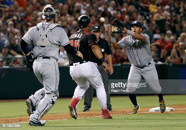 Yangervis Solarte of the San Diego Padres fields the throw from catcher Derek Norris of the Padres as Yasmany Tomas of the Arizona Diamondbacks gets...