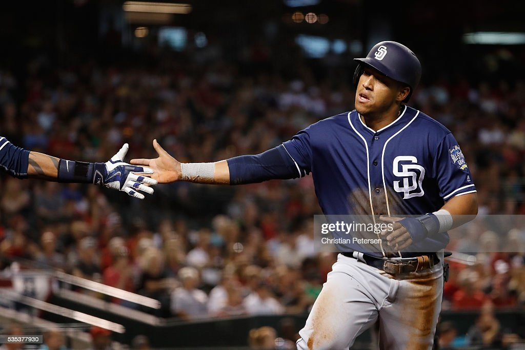 <a gi-track='captionPersonalityLinkClicked' href=/galleries/search?phrase=Yangervis+Solarte&family=editorial&specificpeople=9013250 ng-click='$event.stopPropagation()'>Yangervis Solarte</a> #26 of the San Diego Padres high-fives a teammate after scoring a second-inning run against the Arizona Diamondbacks during the MLB game at Chase Field on May 29, 2016 in Phoenix, Arizona.