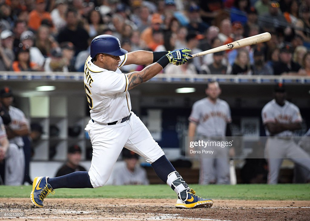 Yangervis Solarte #26 of the San Diego Padres hits a single during the seventh inning of a baseball game against the San Francisco Giants at PETCO Park on September 24, 2016 in San Diego, California.