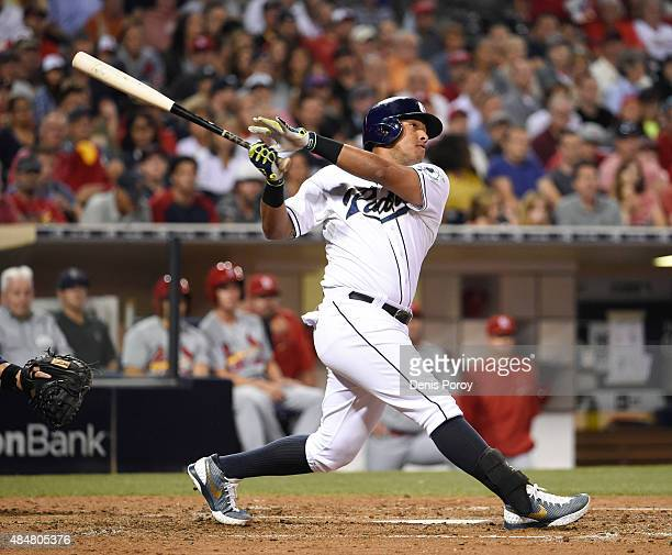 Yangervis Solarte of the San Diego Padres hits a tworun home run during the fifth inning of a baseball game against the St Louis Cardinals at Petco...