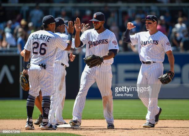 Yangervis Solarte of the San Diego Padres left Franchy Cordero and Hunter Renfroe high five after beating the Cincinnati Reds 42 in a baseball game...