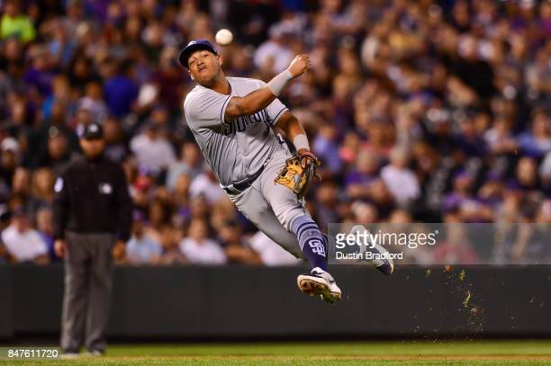 Yangervis Solarte of the San Diego Padres makes a leaping throw to first base for an out after fielding a grounder barehanded against the Colorado...