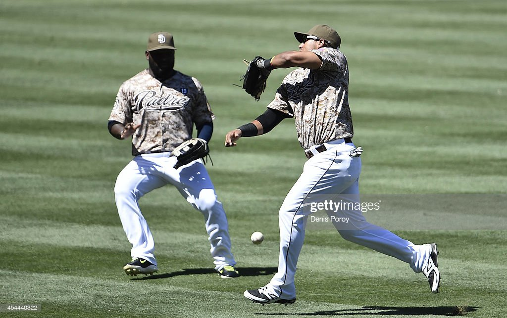 <a gi-track='captionPersonalityLinkClicked' href=/galleries/search?phrase=Yangervis+Solarte&family=editorial&specificpeople=9013250 ng-click='$event.stopPropagation()'>Yangervis Solarte</a> #27 of the San Diego Padres, right, and Abraham Almonte #16 can't make the catch on a single hit by Adrian Gonzalez #23 of the Los Angeles Dodgers during the fifthinning of a baseball game at Petco Park August, 31, 2014 in San Diego, California.