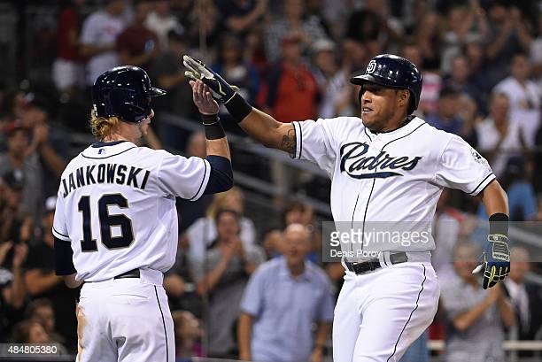 Yangervis Solarte of the San Diego Padres right is congratulated by Travis Jankowski after hitting a tworun home run during the fifth inning of a...