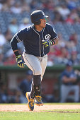 Yangervis Solarte of the San Diego Padres runs to first base during a baseball game against the Washington Nationals at Nationals Park on July 24...