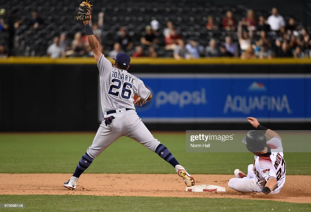 Yangervis Solarte #26 of the San Diego Padres stretches to make a play on a high throw as Brandon Drury #27 of the Arizona Diamondbacks is forced out at second base during the fifth inning at Chase Field on April 26, 2017 in Phoenix, Arizona.