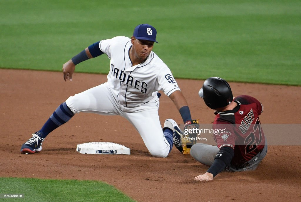Yangervis Solarte #26 of the San Diego Padres tags out Brandon Drury #27 of the Arizona Diamondbacks as he tries to steal second base during the second inning of a baseball game at PETCO Park on April 19, 2017 in San Diego, California.