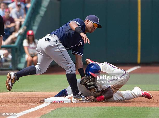 Yangervis Solarte of the San Diego Padres tags out Odubel Herrera of the Philadelphia Phillies in the bottom of the first inning on August 30 2015 at...