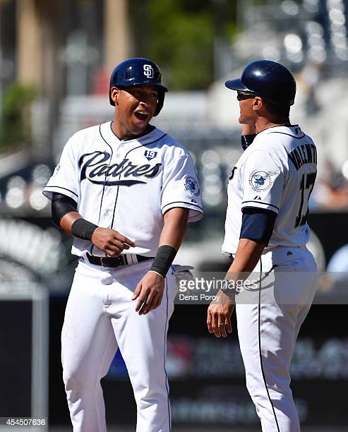 Yangervis Solarte of the San Diego Padres talks with teammate Jose Valentin during a baseball game against the Colorado Rockies at Petco Park August...