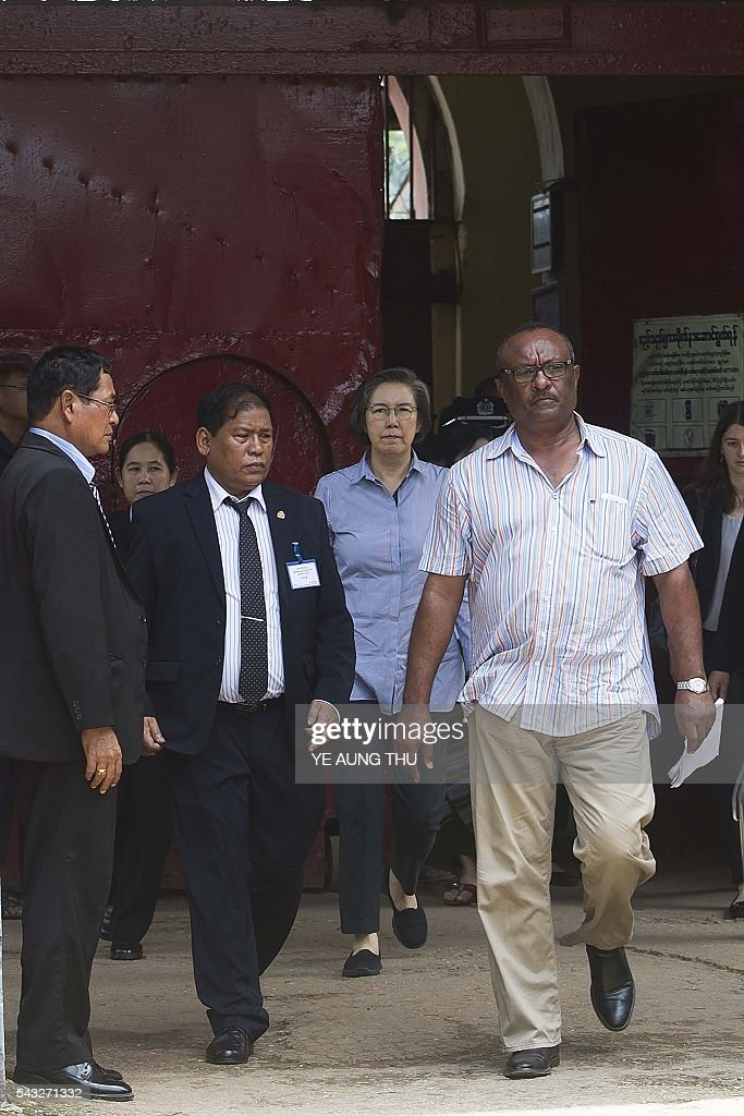 Yanghee Lee (back C), the United Nations Special Rapporteur on the situation of human rights in Myanmar, leaves after a visit at Central Prison Insein in Yangon on June 27, 2016. Lee is on her fourth visit to Myanmar from June 19 to July 1. / AFP / YE