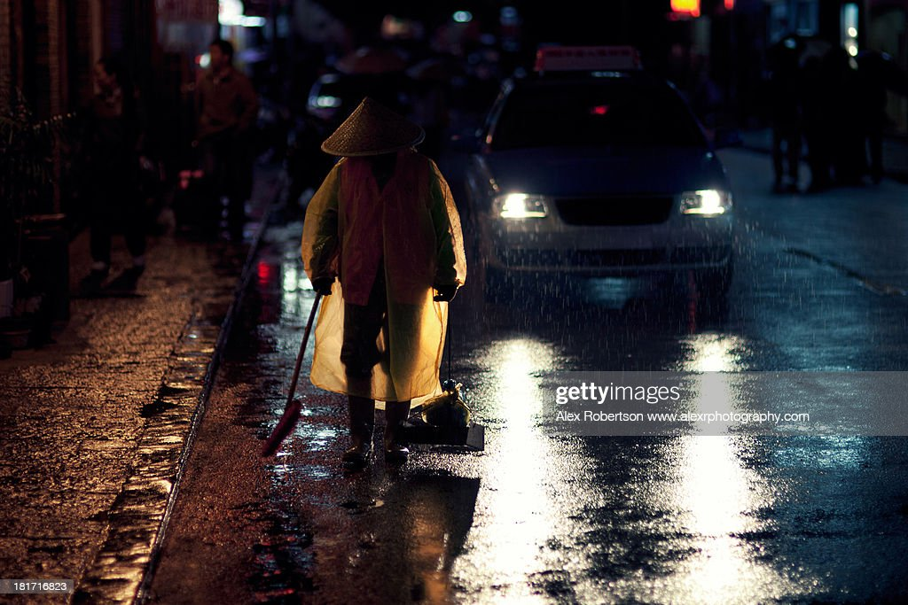 Yangshuo street sweeper at night : Stock Photo