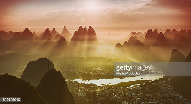 Yangshuo town river Li and karst mountains at sunrise