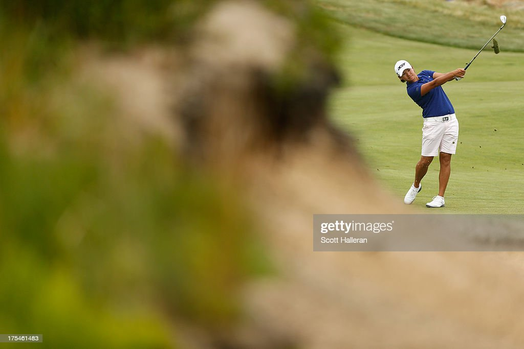 <a gi-track='captionPersonalityLinkClicked' href=/galleries/search?phrase=Yani+Tseng&family=editorial&specificpeople=4682916 ng-click='$event.stopPropagation()'>Yani Tseng</a> hits a shot during the second round of the 2013 U.S. Women's Open at Sebonack Golf Club on June 28, 2013 in Southampton, New York.
