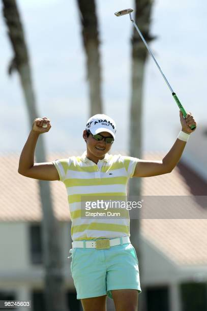 Yani Tseng of Taiwan celebrates after making the final putt suring the final round of the Kraft Nabisco Championship at Mission Hills Country Club on...