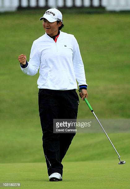 Yani Tseng of Taiwan celebrates holing an eagle putt on the 18th green during the third round of the 2010 Ricoh Women's British Open at Royal...