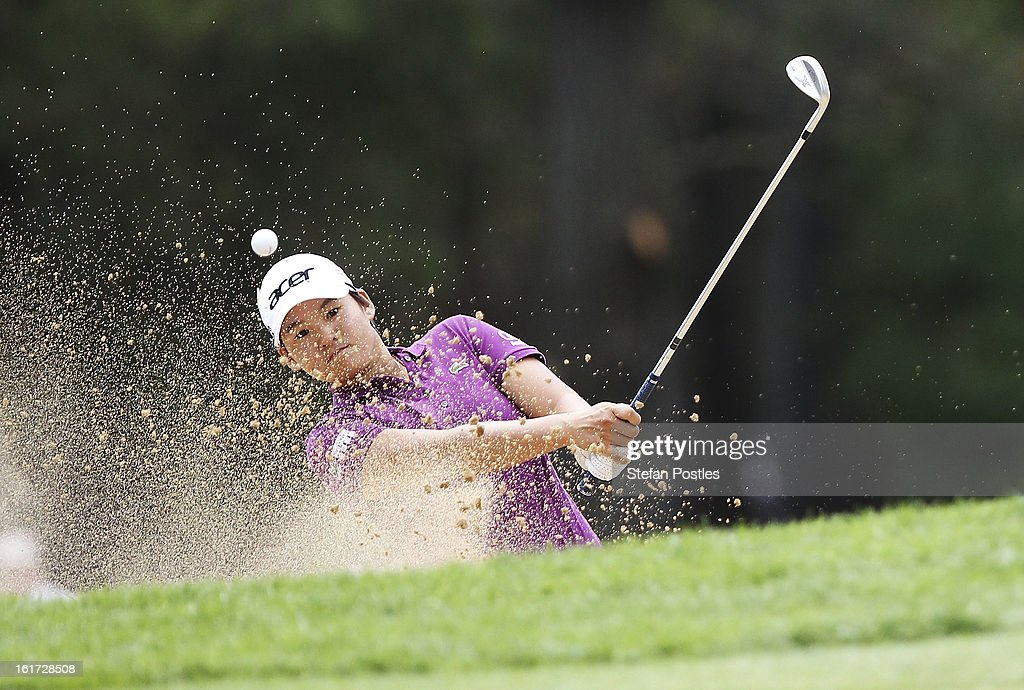 Yani Tseng of Taiwan hits out of the bunker during day two of the ISPS Handa Australian Open at Royal Canberra Golf Club on February 15, 2013 in Canberra, Australia.