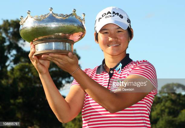 Yani Tseng of Taiwan holds the trophy after winning the Women's Australian Open at The Commonwealth Golf Club on February 6 2011 in Melbourne...