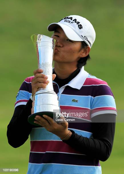 Yani Tseng of Taiwan kisses the trophy after claiming a 1 stroke victory during the final round of the 2010 Ricoh Women's British Open at Royal...