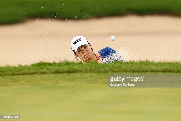 Yani Tseng of Taiwan plays a shot from the bunker during day two of the 2014 Reignwood LPGA Classic at Reignwood Pine Valley Golf Club on October 3...