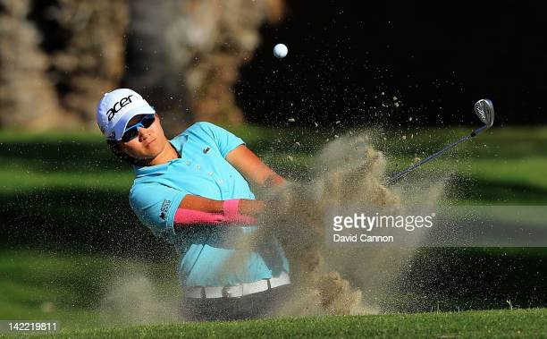 Yani Tseng of Taiwan plays her third shot at the par 4 15th hole during the third round of the 2012 Kraft Nabisco Championship at Mission Hills...