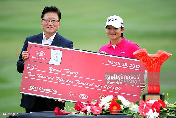 Yani Tseng of Taiwan poses with Byung Mo Ahn Group President and CEO of Kia Motors America and the cheque after winning the the tournament during the...